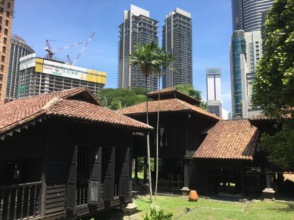 Traditional house surrounded by high-rises